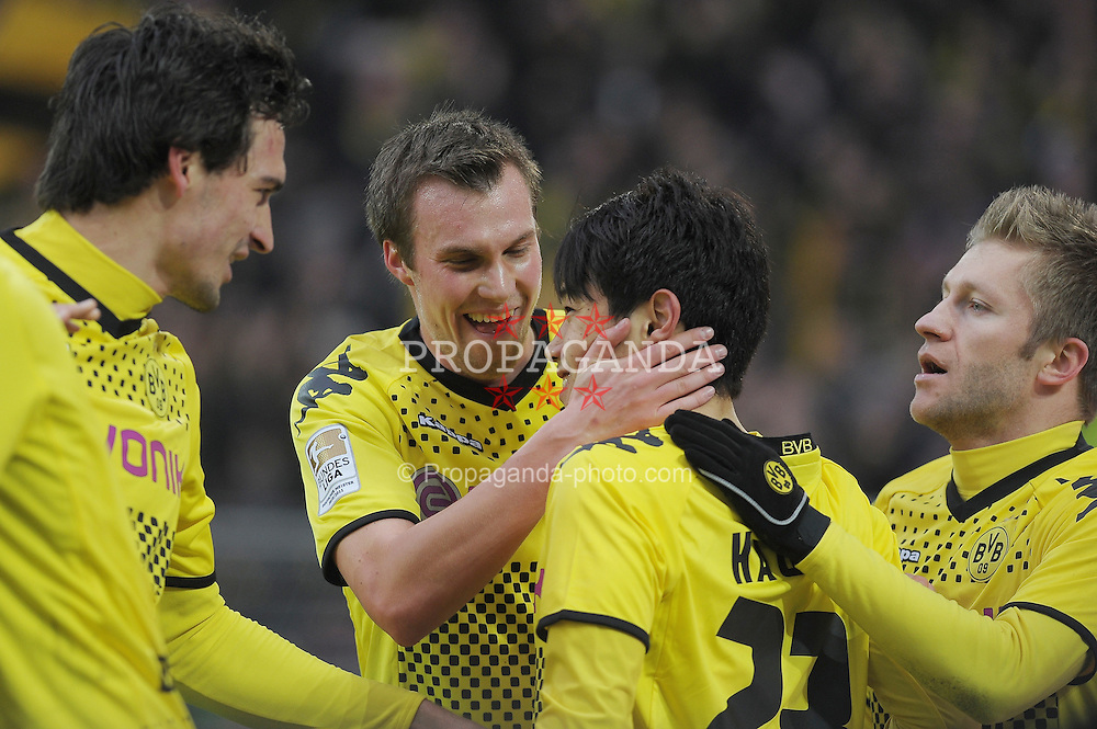 "28.01.2012, Signal Iduna Park, Dortmund, GER, 1. FBL, Borussia Dortmund vs 1899 Hoffenheim, 19. Spieltag, im Bild vl. Mats Hummels (Dortmund #15), Kevin Grovükreutz (Dortmund #19), Shinji Kagawa (Dortmund #23) Torschuetze, Robert Lewandowski (Dortmund #9), Jubel, Torjubel, // during the football match of the german ""Bundesliga"", 19th round, between GER, 1. FBL, Borussia Dortmund and 1899 Hoffenheim, at the Signal Iduna Park, Dortmund, Germany on 2012/01/28. EXPA Pictures © 2012, PhotoCredit: EXPA/ Eibner/ Ulrich Roth..***** ATTENTION - OUT OF GER *****"