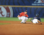 Ole Miss' Kevin Mort tags out Auburn's Creede Simpson, who is caught stealing, during the Southeastern Conference tournament at Regions Park in Hoover, Ala. on Friday, May 28, 2010.  (AP Photo/Oxford Eagle, Bruce Newman)