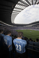 Photo. Jed Wee<br /> Manchester City v Barcelona, Pre-season Friendly, City of Manchester Stadium, Manchester. 10/08/2003.<br /> City fans and the players mourn the loss of Marc Vivien-Foe.