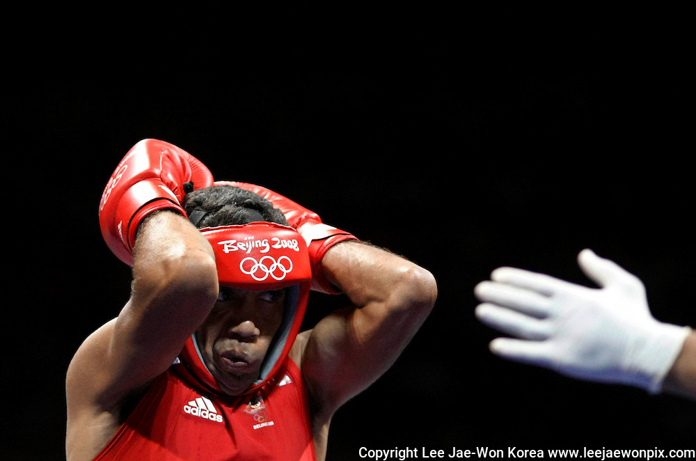 Anthony Little of Australia reacts during his men's lightweight (60kg) round of 16 boxing match against Alexey Tishchenko of Russia at the Beijing 2008 Olympic Games August 15, 2008. /Lee Jae-Won