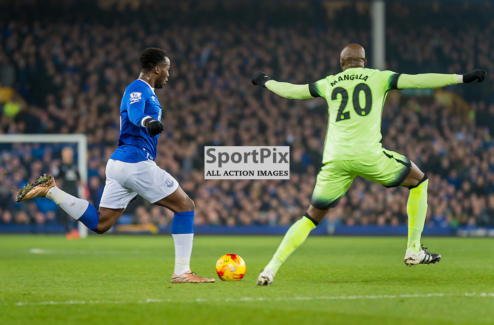 Everton forward Romelu Lukaku and Manchester City defender Eliaquim Mangala challenge for the ballin the Football League cup semi-final first leg at Goodison Park, Liverpool