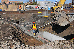 Drainage Pipeline Excavation. Construction Progress Railroad Station Fairfield Metro Center. Site visit 4 of once per month Chronological Documentation. Worker in trench.