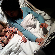 Leilani Frizzelle reads to her daughter Holly Larue, 2 in Larue's room in December 2012. On December 27, 2012 two year old Holly Larue Frizzelle was diagnosed with Acute Lymphoblastic Leukemia. What began as a stomach ache and visit to her regular pediatrician led to a hospital admission, transport to the University of North Carolina Children's Hospital, and more than two years of treatment.