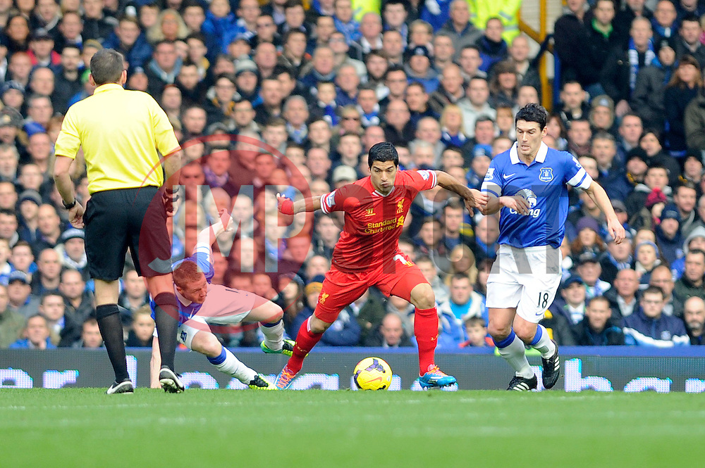 Liverpool's Luis Suarez holds the ball from Everton's Gareth Barry - Photo mandatory by-line: Dougie Allward/JMP - Tel: Mobile: 07966 386802 23/11/2013 - SPORT - Football - Liverpool - Merseyside derby - Goodison Park - Everton v Liverpool - Barclays Premier League