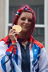 © under license to London News Pictures. 25/06/12..Jessica-Jane Applegate, Paralympic swimming gold medalist in the Olympic parade. Britain's generation of athletes paid tribute to London as up to a million people lined the streets to celebrate the sporting summer. About 800 Olympians and Paralympians were taking part in the parade...ALEX CHRISTOFIDES/LNP