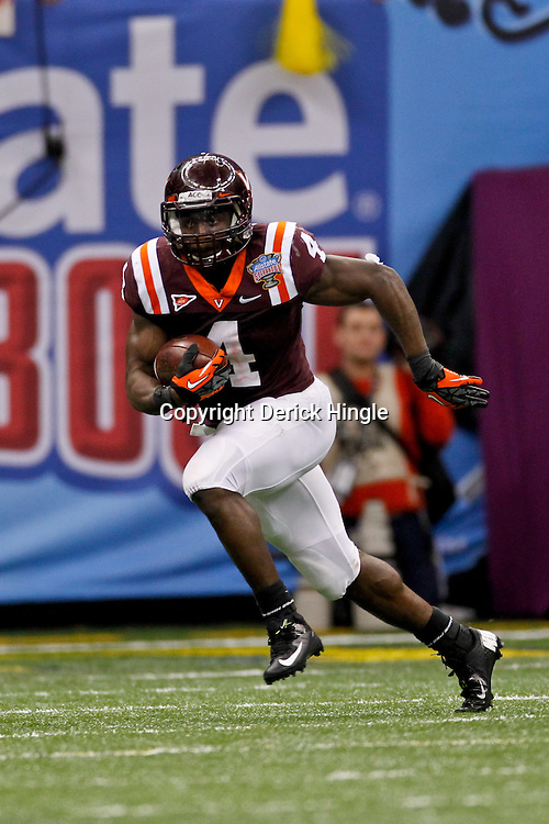 January 3, 2012; New Orleans, LA, USA; Virginia Tech Hokies running back David Wilson (4) against the Michigan Wolverines during the fourth quarter of the Sugar Bowl at the Mercedes-Benz Superdome. Michigan defeated Virginia 23-20 in overtime. Mandatory Credit: Derick E. Hingle-US PRESSWIRE