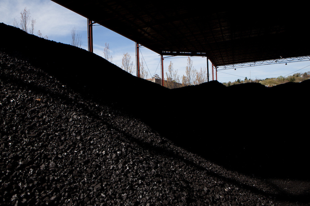 Piles of coal behind the Lausche Power Plant.