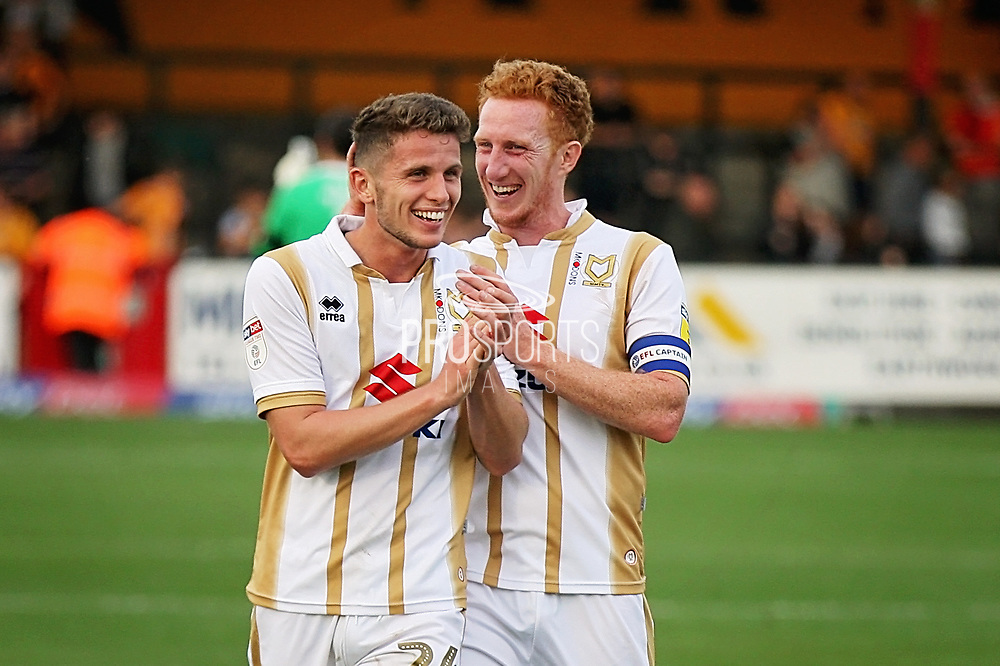 MKDons defender Dean Lewington (3) and MKDons midfielder Jordan Houghton (24) celebrate after the EFL Sky Bet League 2 match between Cambridge United and Milton Keynes Dons at the Cambs Glass Stadium, Cambridge, England on 13 October 2018.