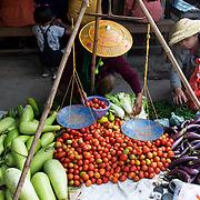 Myanmar (Burma). Inle lake. Nyaungshwe town. Mingala market. Woman selling tomatoes, squash and aubergines.