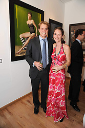 Artist GEORGINA BARCLAY and her husband OLIVER CHURCH at a private view of her work entitled 'Loves & Curiosities' held at the Air Gallery, Dover Street, London on 17th November 2009