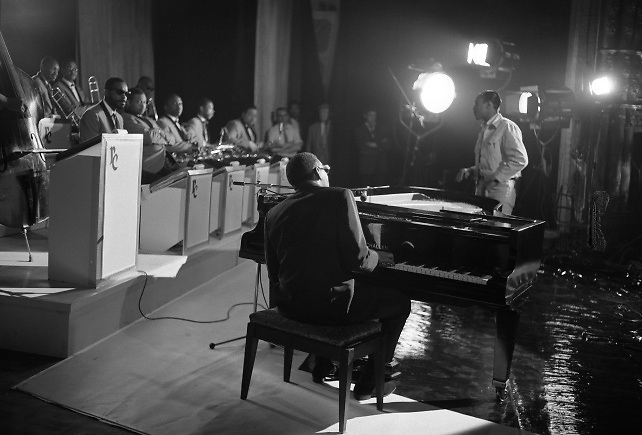 "Singer Ray Charles at the piano at the Gaiety Theatre, filming a scene for the film ""Ballad in Blue""..09.06.1964"