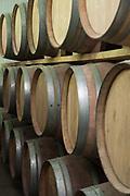 Oak wood aging barrels in a winery storeroom