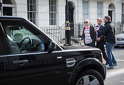 © Licensed to London News Pictures. 06/07/2016. London, UK.  Protestor Michael Culver wears a t-shirt listing the number of dead in the Iraq war as he blocks the convoy of Former Prime Minister Tony Blair as it leaves home. The Iraq Inquiry, Chaired by Sir John Chilcot, is finally being published today, six years after it was started. The long awaited report into the Iraq war, the run-up to the conflict in Iraq, the military action and its aftermath is 2.6 million words long.  Photo credit: Peter Macdiarmid/LNP