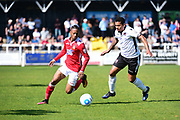 Wrexham Forward Iffy Allen pulls away from Bromley Midfielder George Porter during the Vanarama National League match between Bromley FC and Wrexham FC at Hayes Lane, Bromley, United Kingdom on 8 April 2017. Photo by Jon Bromley.