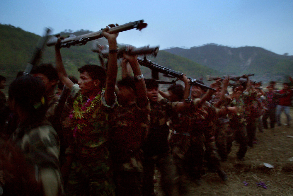 Soldiers from  2nd Battalion of Maoist army dance holding their weapons in the air as they prepare to leave for the mountains after a cultural program and remembrance ceremony in the village of Kholagaun, in the Maoist heartland of Nepal Thursday April 22, 2004.  In the mountains of Nepal, one of the world's last full-blown Maoist revolutions is thriving/forging ahead/gaining ground. The doctrines of Mao, the Chinese communist leader who believed in communism via an empowered peasantry, have found new life in the farm fields of this Himalayan kingdom. The rebels contend their revolution _ which has cost more than 9,500 lives _ is only possible through the barrel of a gun.