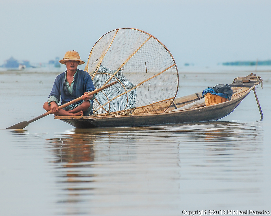 A fisherman with a traditional bamboo net on Inlé Lake, Burma (Myanmar)