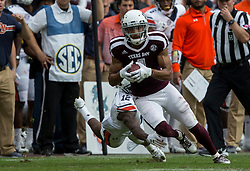 Texas A&M wide receiver Damion Ratley (4) avoids a tackle by Auburn defensive back Jamel Dean (12) for a gain during the fourth quarter of an NCAA college football game on Saturday, Nov. 4, 2017, in College Station, Texas. (AP Photo/Sam Craft)
