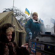 December 19, 2013 - Kiev, Ukraine: A pro-EU demonstrator distributes tea at the Independence Square.<br /> On the night of 21 November 2013, a wave of demonstrations and civil unrest began in Ukraine, when spontaneous protests erupted in the capital of Kiev as a response to the government&rsquo;s suspension of the preparations for signing an association and free trade agreement with the European Union. Anti-government protesters occupied Independence Square, also known as Maidan, demanding the resignation of President Viktor Yanukovych and accusing him of refusing the planned trade and political pact with the EU in favor of closer ties with Russia.<br /> After a days of demonstrations, an increasing number of people joined the protests. As a responses to a police crackdown on November 30, half a million people took the square. The protests are ongoing despite a heavy police presence in the city, regular sub-zero temperatures, and snow.  (Paulo Nunes dos Santos/Polaris)