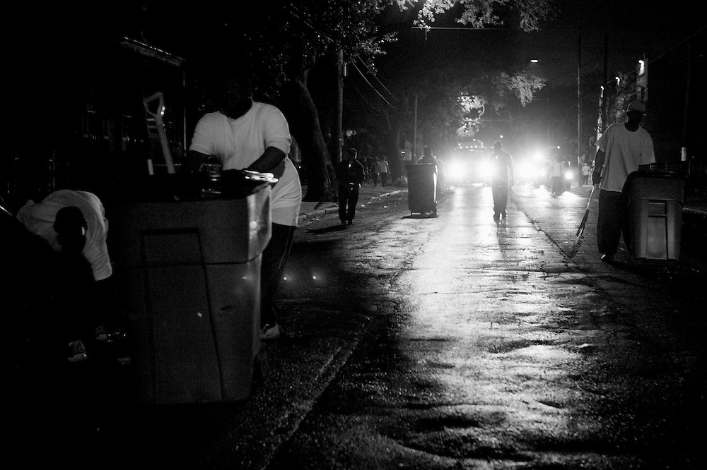 Cleaners pick up Mardi Gras in New Orleans. Kris Ugarriza - Red Wave Pictures