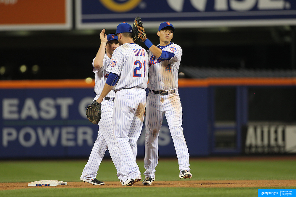 Wilmer Flores, (right), Daniel Murphy, (left) and Lucas Duda, New York Mets, celebrate their sides win during the New York Mets Vs Washington Nationals. MLB regular season baseball game at Citi Field, Queens, New York. USA. 1st August 2015. (Tim Clayton for New York Daily News)