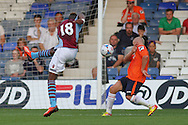 Picture by David Horn/Focus Images Ltd +44 7545 970036<br /> 23/07/2013<br /> Scott Grifiths (right) of Luton Town blocks a shot from Yacouba Sylla (left) of Aston Villa during the Pre Season Friendly match at Kenilworth Road, Luton.
