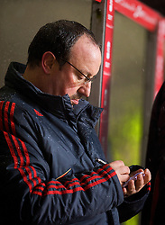 BIRMINGHAM, ENGLAND - Tuesday, December 29, 2009: Liverpool's manager Rafael Benitez makes notes during the Premiership match against Aston Villa at Villa Park. (Photo by: David Rawcliffe/Propaganda)