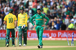 Pakistan's Junaid Khan stands dejected after a wicket is judged as being a no ball during the ICC Champions Trophy, Group B match at Edgbaston, Birmingham.