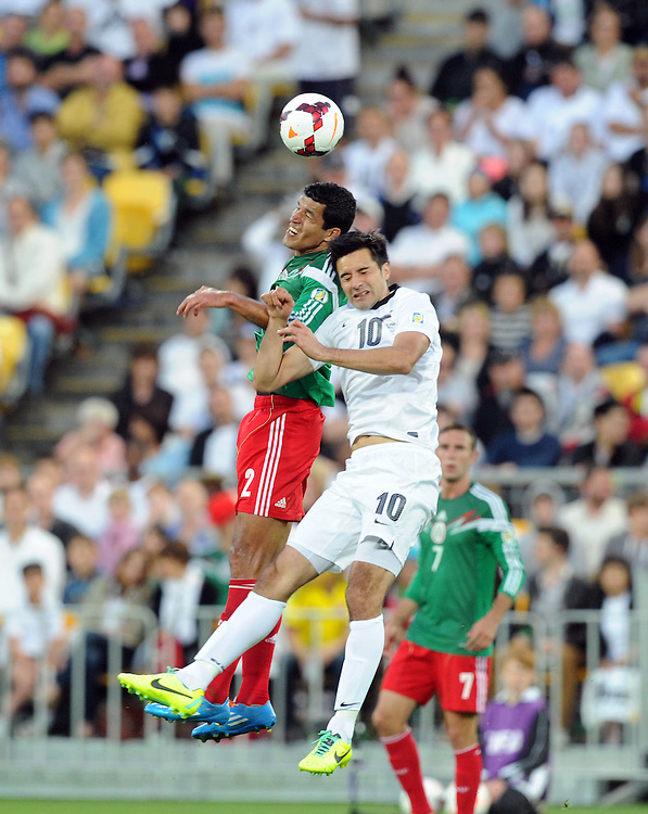 Mexico's Francisco Javier Rodriguez, left and New Zealand's Rory Fallon contest a header in the World Cup Football qualifier, Westpac Stadium, Wellington, New Zealand, Wednesday, November 20, 2013.  Credit:SNPA / Ross Setford