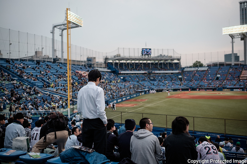 A Supporter of The Tokyo swallows watch the match at the Jingu Baseball Stadium in Tokyo during a game Tokyo Swallows VS Hiroshima Carp, Japan. 21/04/2017-Tokyo, JAPAN