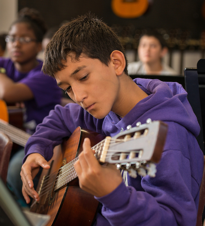 Guitar students practice at Johnston Middle School, October 1, 2014.