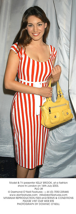 Model & TV presenter KELLY BROOK, at a fashion show in London on 16th July 2003.<br /> PLO 39