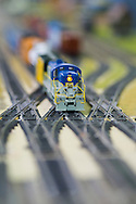 Hicksville, New York, USA. February 22, 2015. A Model Train Exhibit is hosted by Trainville Hobby Depot at the Broadway Mall, including an N Scale layout, the Long Island HOTrack train club HO scale model train portable modular layout, and Long Island Traction Society O Gauge Trolleys. Donations were accepted at exhibit to support the Nassau County Empire State Games for the Physically Challenged.