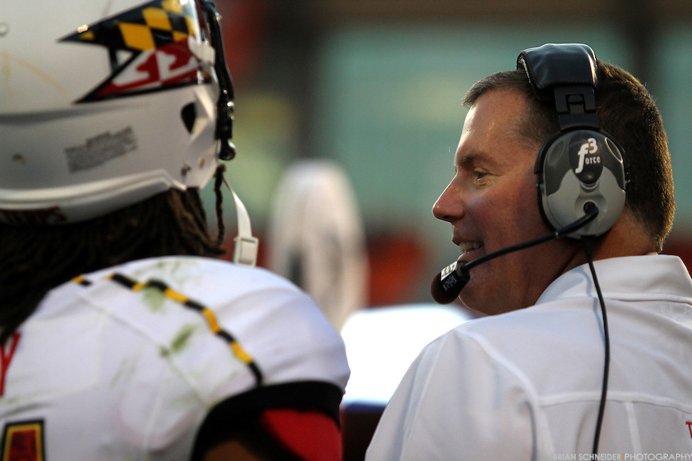 November 10, 2012; Clemson, SC, USA; Maryland Terrapins head coach Randy Edsall (right) talks with quarterback Shawn Petty (31) on the sidelines against the Clemson Tigers in the second half at Memorial Stadium in Clemson, SC. Mandatory Credit: Brian Schneider-www.ebrianschneider.com