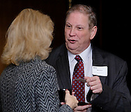 Robin Brun of the University of Dayton Center for Leadership and Executive Development (left) and Mike Kersh of LifePlan Financial Group during the Dayton Area Chamber of Commerce Breakfast Briefing at the Dayton Racquet Club in downtown Dayton, Friday, January 13, 2012.