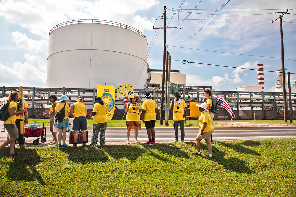 "Members of the Coalition against Death Alley and supporters  march by petrochemcial plants in Geismar, Louisiana aon the third day of a five day march through Louisiana's 'Cancer Alley' held by the Coalition Against Death Alley after being denied permits to march over river crossings. The Coalition Against Death Alley (CADA), is a group of Louisiana-based residents and members of various local and state organizations, is calling for a stop to the construction of new petrochemical plants and the passing of stricter regulations on existing industry in the area that include the groups RISE St. James, Justice and Beyond, the Louisiana Bucket Brigade, 350 New Orleans, and the Concerned Citizens of St. John.  Louisiana's Cancer Alley, an 80-mile stretch along the Mississippi River, is also known as the ""Petrochemical Corridor,"" where there are over 100 petrochemical plants and refineries ."