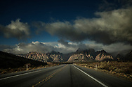 Empty highway into Red Rock Canyon as a winter storm clears.  Las Vegas, Nevada.