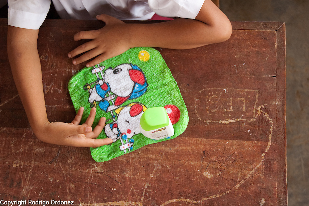 A student at Elementary School 14 in Sungai Geringging follows instructions from Save the Children staff about the importance of washing hands in the aftermath of the West Sumatra earthquake.