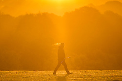 CAPTION CORRECTION<br /> © Licensed to London News Pictures. 22/10/2018. Leeds UK. A dog walker at sunrise this morning at Temple Newsam park in Leeds this morning on a sunny start to the day in Yorkshire. Photo credit: Andrew McCaren/LNP