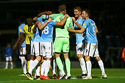 Southend players celebrate after the final whistle during the EFL Sky Bet League 1 match between Burton Albion and Southend United at the Pirelli Stadium, Burton upon Trent, England on 2 October 2018.