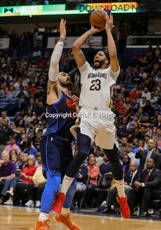 Apr 1, 2018; New Orleans, LA, USA; New Orleans Pelicans forward Anthony Davis (23) shoots over Oklahoma City Thunder center Steven Adams (12) during the second half at the Smoothie King Center. The Thunder defeated the Pelicans 109-104. Mandatory Credit: Derick E. Hingle-USA TODAY Sports