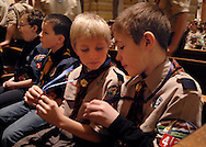 "5 FEB. 2012 -- ST. LOUIS  -- Cub Scouts Michael Vonder Haar (center) and Nolan Hall (right) of St. Joseph Catholic Church of Imperial, Mo. examine their Parvuli Dei ""Children of God"" awards during Scout Sunday prayer service at the Cathedral Basilica of St. Louis led by the Most Rev. Edward F. Rice, Auxiliary Bishop, Sunday, Feb. 5, 2012.  Photo © copyright 2012 Sid Hastings."
