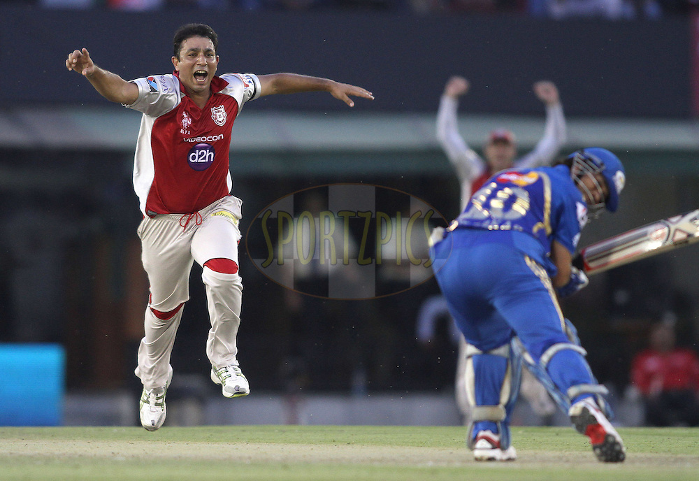 Azhar Mahmood of the Kings XI Punjab celebrates after getting Sachin Tendulkar of the Mumbai Indians wicket during match 33 of the the Indian Premier League (IPL) 2012  between The Kings X1 Punjab and The Mumbai Indians held at the Punjab Cricket Association Stadium, Mohali on the 25th April 2012..Photo by Shaun Roy/IPL/SPORTZPICS