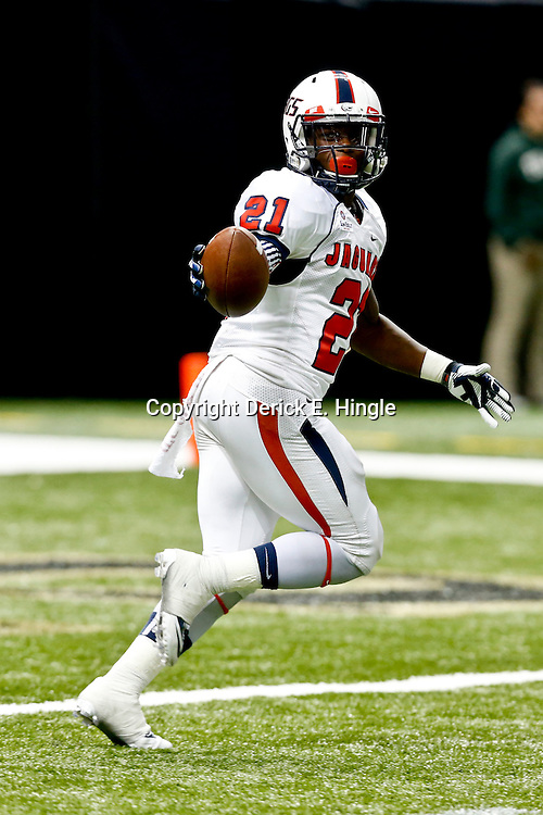 Sep 7, 2013; New Orleans, LA, USA; South Alabama Jaguars running back Terrance Timmons (21) celebrates after recovering a blocked punt in the endzone for a touchdown during the second half of a game against the Tulane Green Wave at the Mercedes-Benz Superdome. South Alabama defeated Tulane 41-39. Mandatory Credit: Derick E. Hingle-USA TODAY Sports