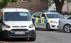© Licensed to London News Pictures. 26/05/2018. Crawley, UK. Police vehicles are seen parked near a block of flats in Crawley after a woman was found dead.  A man has been arrested on suspicion of murder after the woman was found in her bed. Police are appealing for witnesses to come forward.  Photo credit: Peter Macdiarmid/LNP