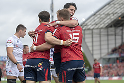 October 20, 2018 - Limerick, Ireland - Mike Haley of Munster celebrates his scoring with Joey Carbery and Darren Sweetnam during the Heineken Champions Cup match between Munster Rugby and Gloucester Rugby at Thomond Park in Limerick, Ireland on October 20, 2018  (Credit Image: © Andrew Surma/NurPhoto via ZUMA Press)