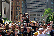 June 18, 2011, Boston, MA - Fans begin to cheer as the first look at thelead Duck boat can be seen down the street. Photo by Lathan Goumas.