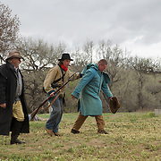 Desertion was treated harshly in the Civil War - on both sides - those caught often faced a firing squad on the spot once caught, as reenacted here. After drawing straws, both actors here decided to make a break for it, with one being marched back to the line...the other you can see laying in the field.