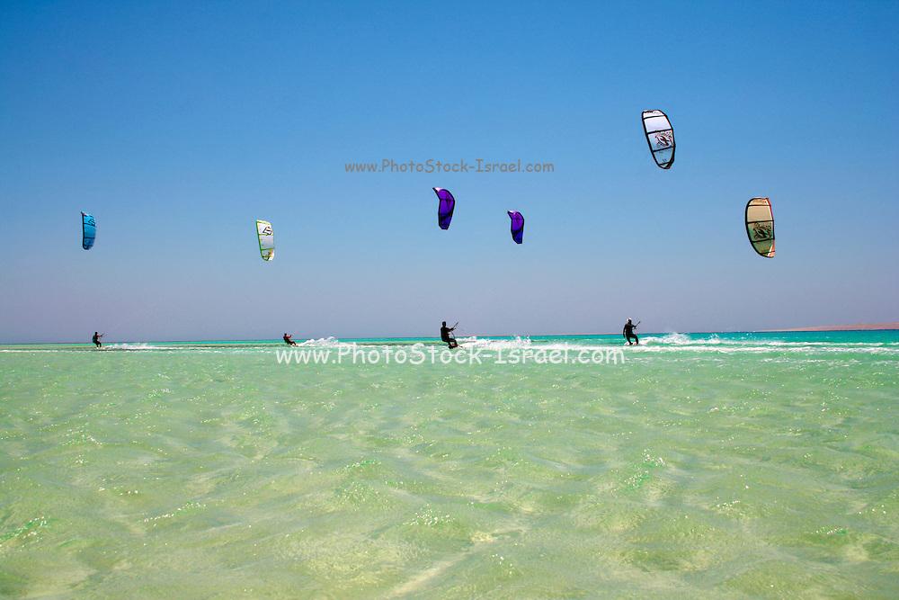 six kite surfers