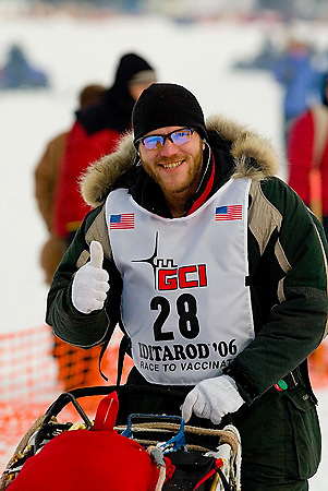 05 March 2006: Willow, Alaska - Rookie Noah Burmeister (28) gives a thumbs up as he heads out during the restart of the 2006 Iditarod on Willow Lake in Willow, Alaska