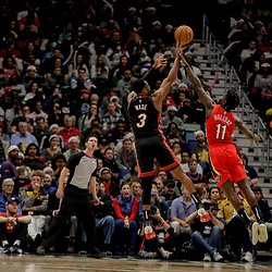 Dec 16, 2018; New Orleans, LA, USA; Miami Heat guard Dwyane Wade (3) shoots over New Orleans Pelicans guard Jrue Holiday (11) during the second half at the Smoothie King Center. Mandatory Credit: Derick E. Hingle-USA TODAY Sports